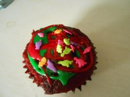 My dinosaur in lava cup cake (red velvet flavor) by LookAtMeImaNeko