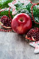 Pomegranate and apple with festive decorations by BeKaphoto