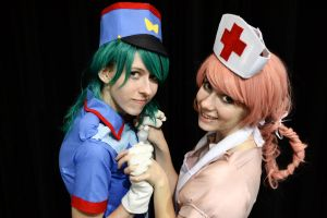 Nurse Joy and Officer Jenny by Smikimimi