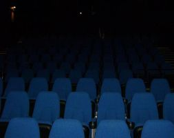 The Lone Moviegoer by FangsAndNeedles