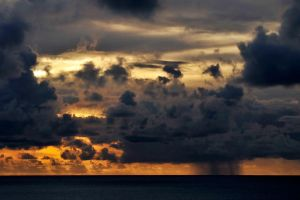 Sunset rain 1 - Easter Island by wildplaces