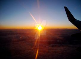 Sunset viewed from a plane by John-Furie-Zacharias