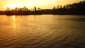 Rainy Sunset Lake by FiresFlame