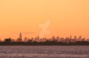 A distant view of New York City at sunset by ArtieWallace
