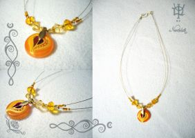 Orange glass spin by Tuile-jewellery