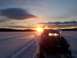snowmobile in the sunset by ffilip