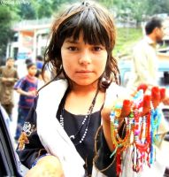 Muslim Girl Selling Hand Made Bracelets by TheGlobalVariety