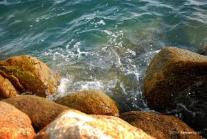 The sea washing the rock by sarthahirah