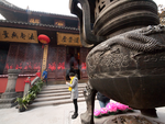 Woman Outside Jade Buddha Temple, Shanghai by vanfoto