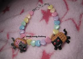 Nyan cat bracelet:rainbow love by gothic-yuna