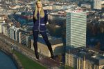 Giantess Laura Vandervoort observing the town by ilikemercs