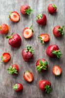 Strawberries  on wooden table by BeKaphoto