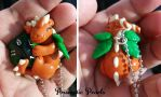 Pumpkin Inspired Baby Dragon D20 Necklace by prismaticpearls