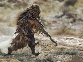 Snipe in ghillie on a dried desert. by OutOfFlames