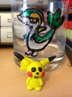 My Pikachu model and Snivy glass by SonicAngel23