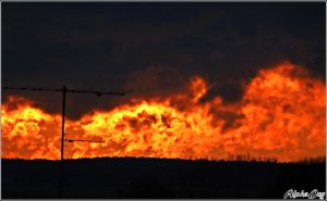 clouds on fire by Alpha-Dog