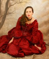 red dress sitting by magikstock