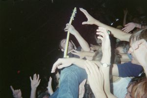 guitarist crowdsurfing by bleedinglipgloss