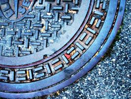 manhole cover by pooka-stock