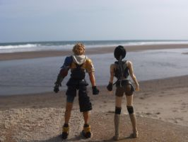 Yuffie and Tidus on the beach by kingdomhearts800