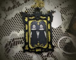 Laser Cut Frame and Creepy Twins Necklace by asunder