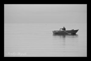 Lonely man on a boat by Eternal-Polaroid