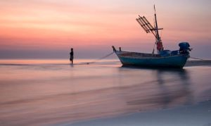 boat on beach by YellowCupOfTea