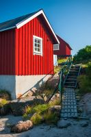 Red houses by the shore by Sekundkvadrat