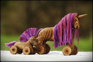 Unicorn wooden toy by pagan-art