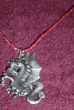 Fire-colored dragon necklace by lividun