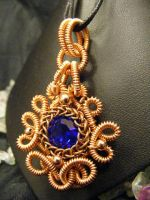 coiled persain chaton pendant by BacktoEarthCreations