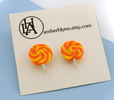yellow and orange lollipop studs on display card by amberhlynn