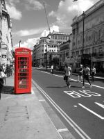 Red telephone box in London by Lowe-Light