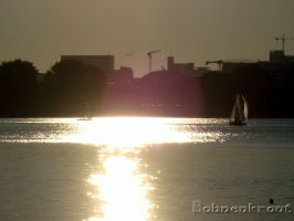 Reflection of the sun with sailing boat by EvilBohnenkraut