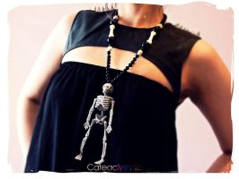 Silver Glitter Skeleton Necklace by Cateaclysmic