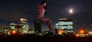 Michelle Lewin sitting on a skyscraper at night by danforddan
