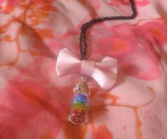 Rainbow bead vial Necklace with pink bow by Ravingkangaroo