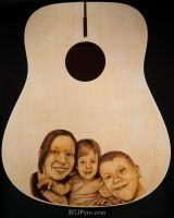 Pyrography portrait of family on guitar by brandojones