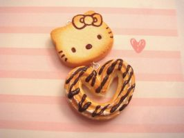 Hello Kitty Pancake and Heart Drizzled Churro by tiramisuxfluff