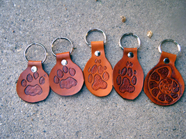 Feline, Canine and Ammonite shell keychains-fobs by cloudstar-wolf