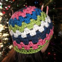 Multi-coloured crocheted hat by weblore