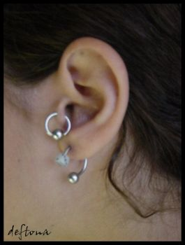 Tragus and Ear Piercing by tattoos