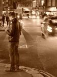 Man on street texting, waiting by SusanMMM