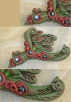 Green and Bronze bird magnet by Stormphyre
