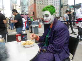 Joker enjoying fries by Etrigan423