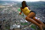 Giantess Laying Across City by ilikemercs