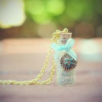 Blue Ribbon Tied Sand in Bottle Reminder Necklace by VintageLightJewelry