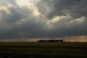 Sunbeams through clouds 1 by wildplaces