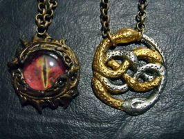 Auryn And Eye Of Sauron chained Charms by smeagolisme