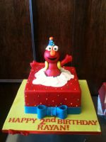 Sculpted Elmo Present Cake by Spudnuts